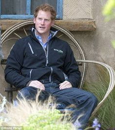 An early start! Prince Harry takes a pew in one of the garden's wooden chairs...