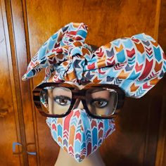 Ready for the season! Abstract bold print in blue, white and copper on white back ground. Headscarf has striped contrast lining and measures 46 by 6 inches. 100% cotton Our cotton masks are made with 2 layers of 100% cotton PLUS additional facing layer. All masks reversible with stretching elastic OR ties for comfort