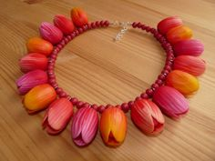 Tulip necklace by Sunflowerjewels (Sunnydesignslimited on Etsy). Wood, base metal clasp.