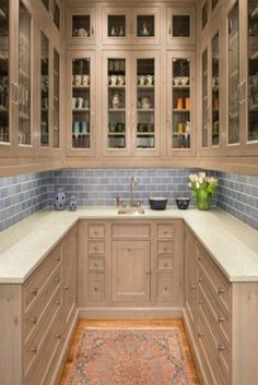 i love this pantry. This is seriously so gorgeous! The neutral gray subway tile backsplash is classy and beautiful. Seriously love it! You will love all of these kitchens! #gorgeouskitchen #kitchengoals #whitekitchen #farmhousepantry #farmhousekitchensick #farmhousekitchen #neutralkitchen #whitefarmhouse #pantry goals #subwaytile #rustickitchen #rustichomedecor #kitchen