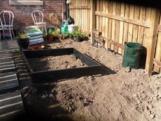 On the other side of the path, at the top, the patio is half the depth, so I'm having a bike shed against the fence, then chessboard type paving with grass & chamomile lawn type herb squares, then in front of it, is my Square Foot Garden - for vegetables (google Mel Bartholomew) and my green compost bin bag.  Then it starts to drop away, and it's going to be fruit bushes and climbers, like red gooseberry, blackberry, black currant etc. But that's for another day!