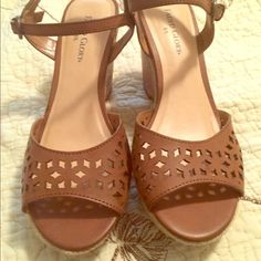 BNIB 6.5 Beautiful brown wedge sandals, in box, never worn, with cutout design. Offers welcome and discounts given on bundles. Help me to clean out my closet. Trades are welcome at a value of  $12. Faded Glory Shoes