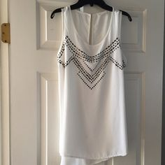 White Metal-Studded Tank Dressy white tank with metal accents adds more pizzaz than an everyday tank. Longer in back. Dress up your cardigans! Excellent condition. Tops Tank Tops