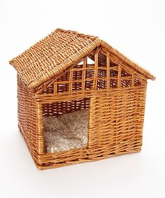 Wicker Pet Cottage. Pretty, but the cats would sharpen claws on it and the dog would chew it!