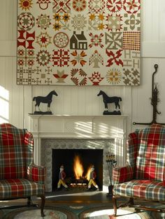 """Another pinner said (what's NOT to love here!): """"A spectacular antique album quilt is hung like a painting over one of the the two fireplaces in the living room.""""---Check out the great plaid chairs!!  :)"""