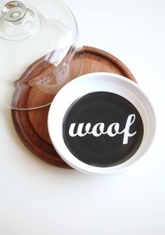 """Woof Woof Dog Bowl  9.99 at shopruche.com. This plastic pet dish features a sleek black and white design.  6"""" diameter, 1"""" deep"""