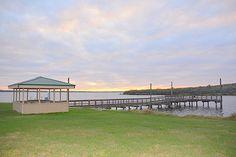 Lake Corpus Christi State Park fish cleaning station & fishing pier at sundown, Mathis, Texas