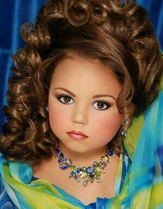 Toddlers and Tiaras she looks like a doll I feel so sorry for those girls