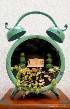 The cutest little fairy garden inside a clock. Includes full plans for making the porch swing and the miniature topiary trees