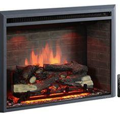 PuraFlame Western Electric Fireplace Insert with Remo. PuraFlame Western Electric Fireplace Insert with Remote Control, Black Electric Fireplace Reviews, Electric Fireplace Heater, Wall Mount Electric Fireplace, Electric Fireplaces, Electric Logs, Indoor Fireplaces, Old Fireplace, Concrete Fireplace, Fireplace Surrounds