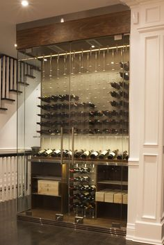 Glass surround reach-in custom wine cellars by Papro Consulting Ltd. are a great way to create big impact in a small space. This one features the Cable Wine System www.cablewinesystems.com