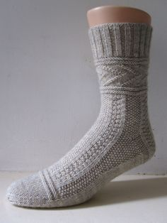 Free Knitting Pattern for Gladys Gansey Socks - This sock featurestextured stitches like those intraditional Guersey / Gansey fishermen's sweaters. Designed by General Hogbuffer who named this after Gladys Thompson who wrotethe bookPatterns for Guernseys, Jerseys & Arans