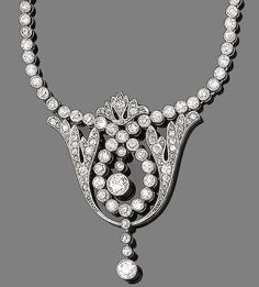 A belle époque diamond pendant necklace, circa 1915. The openwork cartouche of foliate and scrolling design, millegrain-set throughout with old brilliant, single and rose-cut diamonds, suspending two knife-edge bars collet-set with old brilliant-cut diamonds, to a trace-link chain, old brilliant and single-cut diamonds approx. 2.05cts total, length 42.0cm