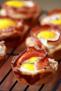 A two bite breakfast: bacon  eggs in toast cups
