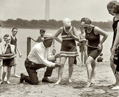 1922 beach police.US modesty laws, no swimsuit higher than 6 inches above the knee..