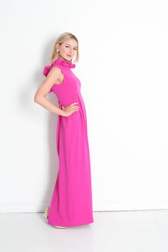 Ruffles! Ruffles! Ruffles! Ruffles around the high neck line and drop back line. The elegance that shines through this dress is contagious. Empire waistline, floor length hem line, center back slit, and gold button snap closure in center back.