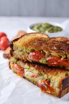 A decadent grilled cheese sandwich made with smoked provolone, roasted tomatoes and sweet pesto. Pesto Grilled Cheeses, Grilled Cheese Recipes, Sandwich Recipes, Grilled Sandwich, Great Recipes, Favorite Recipes, Vegetarian Recipes, Cooking Recipes, Pizza