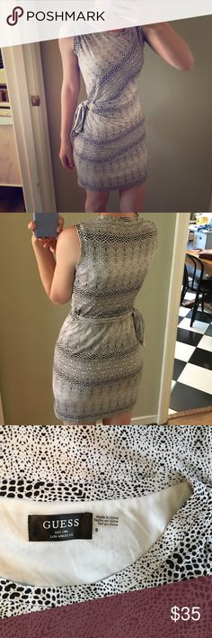 Guess animal print black and white dotted dress Stretchy and very comfortable! Has a tie at the left side waist. New without tags never worn. 95% polyester 5% spandex with white polyester lining. NO TRADESREASONABLE OFFERS WELCOMEOFFER FEATURE TO BE USED FOR ALL PRICE NEGOTIATIONSLEAVE KIND WORDS AND QUESTIONS IF YOU HAVE ANY✌️❤️ Guess Dresses