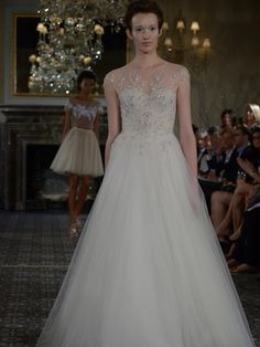 Mira Zwillinger A-line wedding dress with illusion neckline, tulle skirt and lace appliqué from Spring 2016