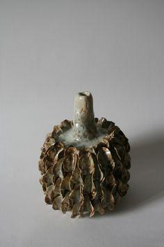 rutine:  White stoneware, glazed + with oxide