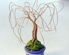 Willow Wire Tree Sculpture. Original by Sal Villano 3.25 Inches Tall. Made of 32 Gauge Copper Wire. This copper wire will patina with age Mounted on Dark Glass using sea sand and bonding agent. The sand is painted with India ink to look like moss covered earth #G623 $ 29.00 FREE SHIPPING TO USA AND CANADA!  You can create this wire tree sculpture, and many others, using my new book available in my ETSY shop! Creating Gem, Beaded & Bonsai Wire Trees Available as a Printed Book and a Downlo...