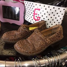 Size 7 Boc Peggy Embossed Brown Leather Shoes B.O.C. Peggy embossed clogs feature a faux leather upper with an embossed paisley design, padded collar, comfortable fabric lining, cushioned foot bed and a durable man made out sole with a 2 inch wedge heel and a 1/2 inch platform. Boc Shoes Mules & Clogs
