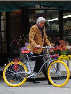 Actor Ted Danson 's colour-popping set of wheels mean he can get away with wearing pretty much any drab old thing when on his cycle. Love his camel-coloured blazer.