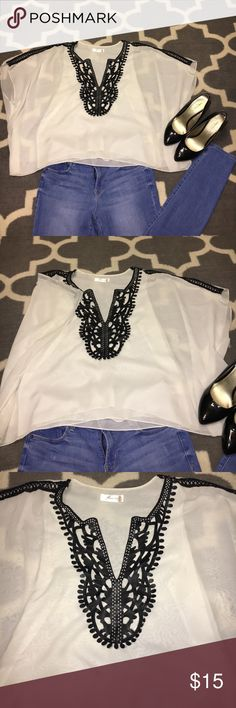 •White and leather blouse• Rocker chic blouse! Leather embroidery with sleeve stitching. Great top for a night out! Very comfortable and flowy Tops Blouses