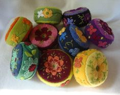 measures 4 x 2, hand dyed wool, hand embroidered, hand crocheted flowers, shell buttons, poly fiberfil. Made to order, allow 5 to 7 days. Due to the hand dyed quality some variations may occur.