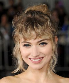 Curly bangs for your face shape plus styling tips and inspo.