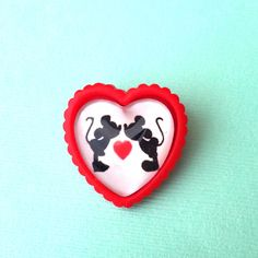 Handmade Heart of Mouse red heart brooch! Inspired by Minnie and Mickey - a Silhouette with a heart in the middle and a white background! This brooch measures 30mm and is made with a custom designed and printed image, glass dome seal, and a silver backing clasp
