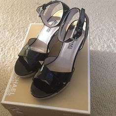 Michael Kors Shoes These black patent Michael Kors platforms are perfect as we gear up for summer! They are a Sz 8 and have only been worn about 2 times. There is a small nick in the left top part of shoe that I have pictured! MICHAEL Michael Kors Shoes