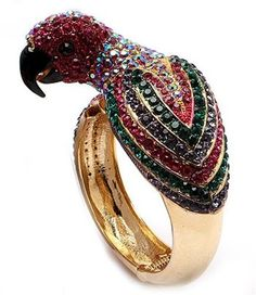 Normally, I don't like gold jewelry, but I'm drawn to this parrot bracelet.  It looks like the parrot contains tons of my ruby birthstones for July.