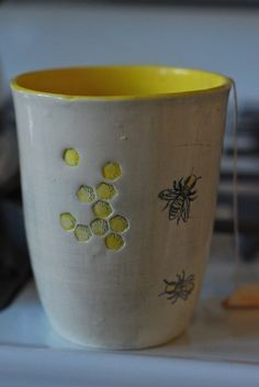 Lovely handmade pottery bumble bee themed cup or mug. Love the yellow interior.