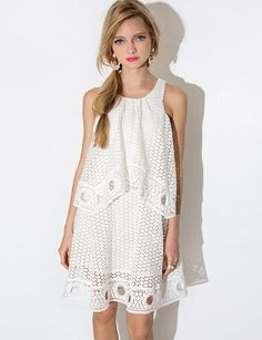 Pretty white eyelet summer dress with halter asymmetric top layer and ring hem. Lined with hidden zip closure. *Cotton blend*Length 33