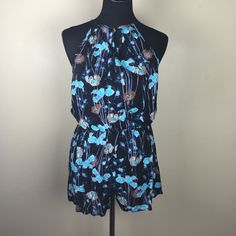 ⚡️FLASH SALE⚡️Black and Blue Floral Romper Super cute black and blue floral romper with open back (see pic). New item; never been worn. If interested, please let me know what size you would like and I will create a separate listing for you. I have a small, medium and large available. Dresses