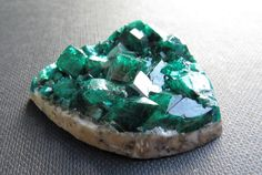 A personal favorite from my Etsy shop https://www.etsy.com/listing/454189662/dioptase-cabochon-altyn-tube-kazakhstan