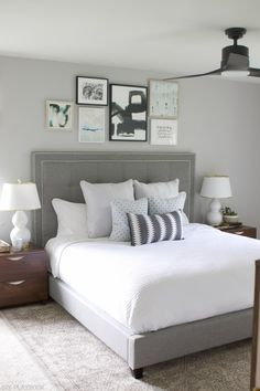 Love this gray, white, and black bedroom space. Such a great neutral color combo. The fluffy pillows from HomeGoods make the bed look so cozy and pulled together (Sponsored Pin)