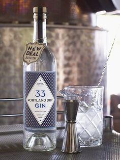 Updated label design for New Deal 33 Portland Dry Gin by Deluxe Creative.