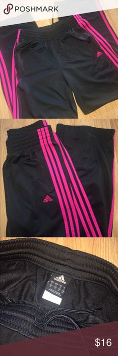 Adidas Women's Athletic Workout Pants Black Medium Adidas women's black workout pants. Pink adidas logo and stripes going down each the side of the leg. 100% polyester. In great condition! adidas Pants