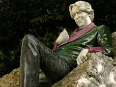 Oscar Wilde statue in Merrion Square Gardens, Dublin. The statue is located across the street from the house where his family lived.