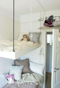Put storage under the lower bed, and it will still look open and airy.  Attach a taut rope from the top bunk to the bottom for easier access--will also add stability.