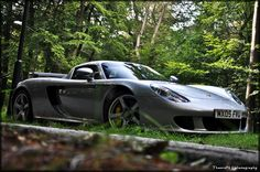 One of the most beautiful cars standing at the side of the road in the forest in Apeldoorn, The Netherlands. The owner has many more supercars including a Bugatti Veyron. Hope you like this shot.