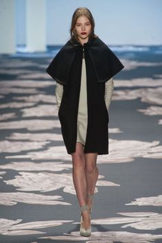 Vera Wang played both sides for Fall 2013. There was the sculpted, angular, high-contrast beginning. She experimented with silhouettes and shapes with cut-outs, paneling and volume.   - HarpersBAZAAR.com