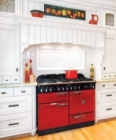 You can build a custom wood mantel to conceal your vent hood, or purchase one similar to shown from Air-Pro in unfinished 60-inch red oak with detachable-front mantel hood, about $1,580; kitchensource.com. | Photo: Janis Nicolay | thisoldhouse.com