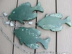 """A stringer of wooden fish can hang indoors or out and remind you of your best days on the lake! Each fish is approximately 9""""x5"""". They are cut from 3/4"""" thick lumber for a nice heavy hanging weight."""