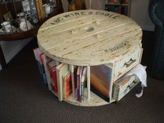 Books, wine rack and a set of drawers in repurposed cable spool. Cable reel