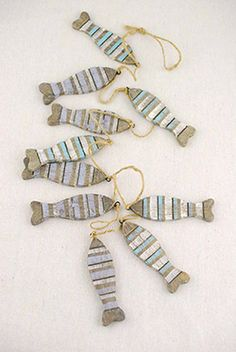 13.99 SALE PRICE! Decorate your beach inspired home or event with this Driftwood Fish Garland! The garland is composed of wood fish painted in two colors, ei...