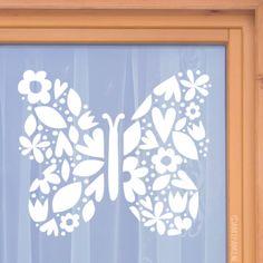 #raamtekening ontwerp, geïnspireerd door papercutting. Een silhouette van een vlinder bestaande uit verschillende Lente vormen zoals bloemetjes, blaadjes en meer.