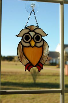 Stained Glass Owl. Would like better in darker browns other than that perfect!!